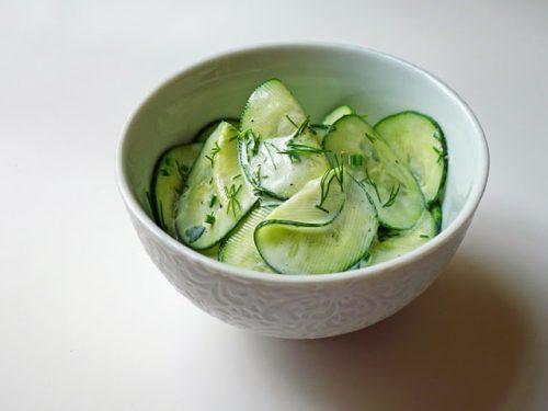 Bowl of sliced cucumber salad with Bragg Apple Cider Vinegar
