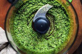 bledning ingredients for vegan pesto in a food processor