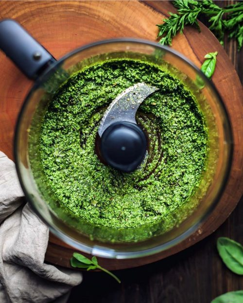 bledning ingredients for vegan pesto in a food processor